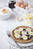 Freshly prepared crepes with banana & blueberries Royalty Free Stock Photo