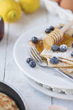 Freshly prepared crepes with blueberries Royalty Free Stock Image