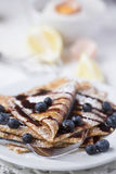 Freshly prepared crepes with blueberries Stock Image