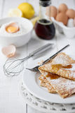 Freshly prepared crepes with maple syrup Royalty Free Stock Photography