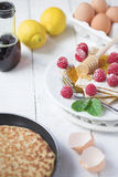 Freshly prepared crepes with raspberries Royalty Free Stock Photography