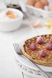 Freshly prepared crepes with raspberries stock images