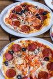 Freshly prepared delicious pizza in the kitchen Stock Photo