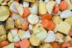 Freshly prepared seasonal Winter vegetables in roasting tin Royalty Free Stock Photos
