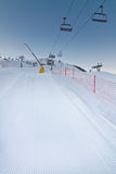 Freshly prepared ski slope with chair lifts Royalty Free Stock Photography