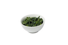 Freshly prepared spinach. Spinach in a ceramic pot Stock Photos