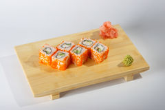 Freshly prepared sushi. Rolls served on a wooden tray with wasabi Royalty Free Stock Photography