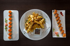 Freshly prepared sushi dish and tempura shrimp Royalty Free Stock Photo