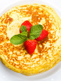 Freshly prepared traditional pancakes with strawberries Stock Photo