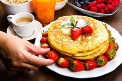 Freshly prepared traditional pancakes with strawberries Royalty Free Stock Photography
