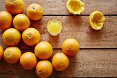 Freshly pressed orange juice and bunch of oranges Royalty Free Stock Image