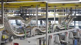 Freshly printed daily newspapers are transported on a conveyor belt in a printing plant stock video