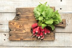 Freshly radish with green leaves on table. Top view.  Stock Photos