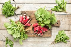 Freshly radish with green leaves on table. Top view.  Royalty Free Stock Images