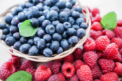Freshly raspberry blueberry fruit antioxidant food. Healthy eating and nutrition freshly raspberry and blueberry fruit antioxidant food Stock Photography