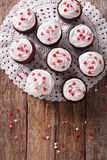 Freshly red velvet cupcakes close-up on the table. vertical top Royalty Free Stock Photos