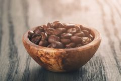 Freshly roasted arabica coffee beans in bowl Royalty Free Stock Images