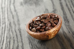 Freshly roasted arabica coffee beans in bowl Stock Images