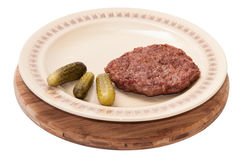 Freshly roasted burger and pickles served on a plate Stock Images
