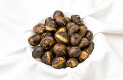 Freshly roasted chestnuts Stock Images