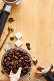 Freshly roasted coffee beans in a glass jar. Coffee background stock photography
