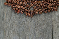 Freshly roasted coffee beans on wooden table Stock Photo