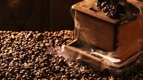 Freshly roasted coffee milled in the mill stock footage