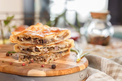 Freshly roasted lamb slices. In a square pie with potatoes and pepper. Culinary subjects. Abstract cake Royalty Free Stock Photography