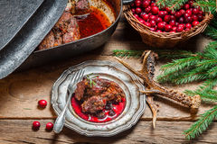 Freshly roasted venison with cranberry sauce and rosemary Royalty Free Stock Image