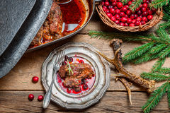 Freshly served venison with cranberries and rosemary Stock Images
