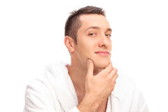 Freshly shaved young man in a white bathrobe Royalty Free Stock Images