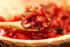Freshly sliced and diced tomatoes in a wooden bowl Royalty Free Stock Photo