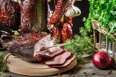 Freshly sliced ham on the table rural Stock Photos