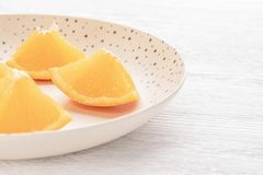 Freshly sliced oranges on a dotted brown plate stock images