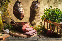 Freshly smoked ham in country smokehouse Royalty Free Stock Photography