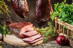 Freshly smoked ham in homemade smokehouse Royalty Free Stock Photography