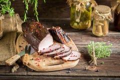 Freshly smoked ham in homemade smokehouse Stock Image