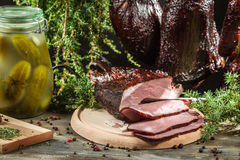 Freshly smoked ham in a rural pantry Royalty Free Stock Image