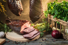 Freshly smoked ham in smokehouse Royalty Free Stock Image