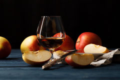Freshly squeezed apple juice in glass and red apples with leaves Royalty Free Stock Photos