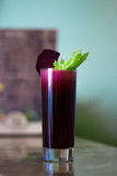Freshly squeezed beetroot juice. Sweet fresh from sugary beets with celery royalty free stock photography
