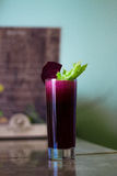 Freshly squeezed beetroot juice. Sweet fresh from sugary beets with celery stock image
