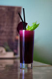 Freshly squeezed beetroot juice. Sweet fresh from sugary beets with celery stock photo