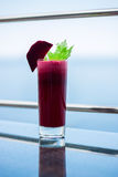 Freshly squeezed beetroot juice. Sweet fresh from sugary beets with celery royalty free stock photos