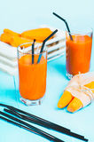 Freshly squeezed carrot juice in the glasses. Stock Photo
