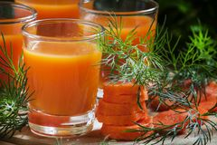 Freshly squeezed carrot juice in glasses, selective focus stock photography