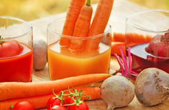 Freshly squeezed carrot juice. Freshly squeezed juices from organic vegetables Stock Photo