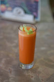Freshly squeezed carrot juice. Sweet fresh from sugary carrot with celery stock images