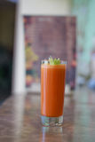 Freshly squeezed carrot juice. Sweet fresh from sugary carrot with celery royalty free stock photography