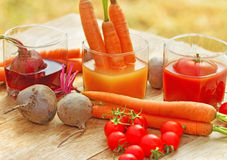 Freshly squeezed juices on table Royalty Free Stock Photography